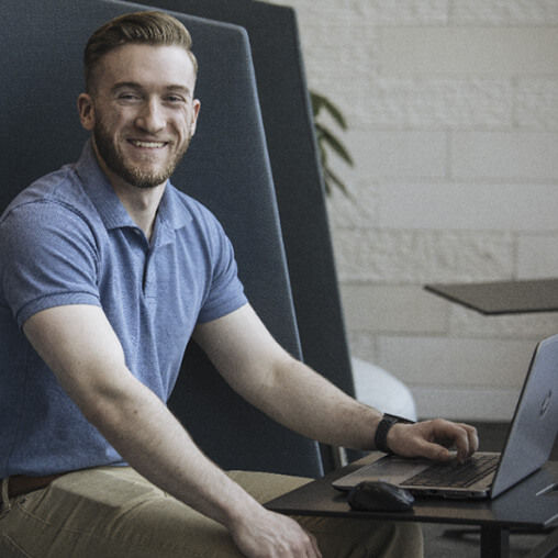 Man working on laptop and smiling