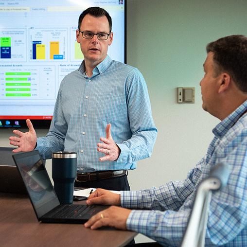 Two men speaking in an office