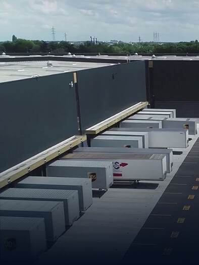 Depot with several trucks inside it