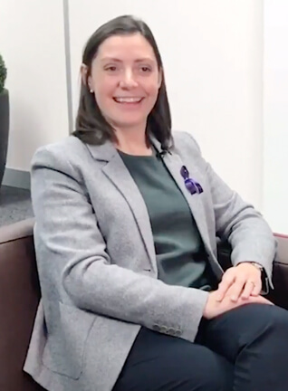 Woman in business suit is smiling