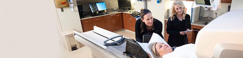 Nurses doing a scan on a patient