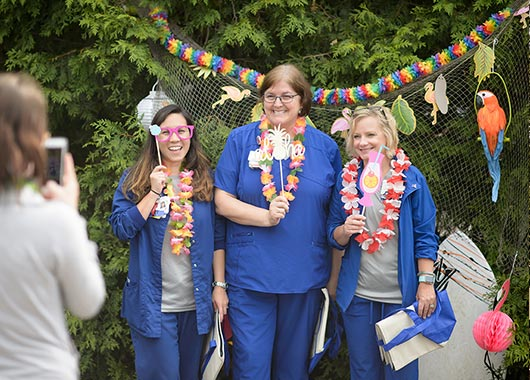 Nurses having fun at a luau-themed party