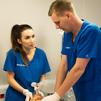 Female and male nurses working together
