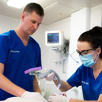 Male and female nurses working together