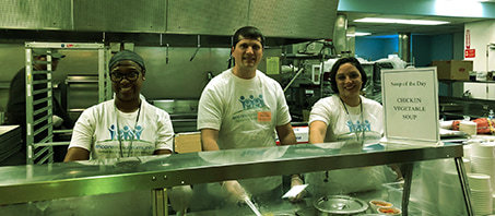 A volunteer cafeteria crew serving the homeless