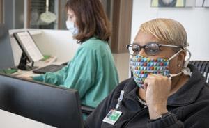 Two nurses siting at a nurses station