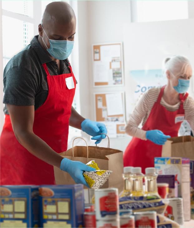 man and woman volunteering