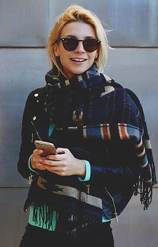 Fashionable young woman using a mobile phone