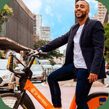 homem sentado em uma bicicleta