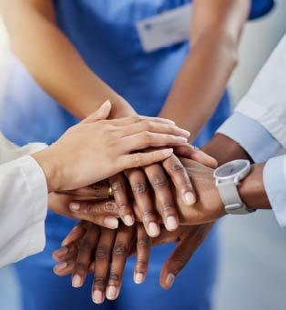 Pic: People touching hands together