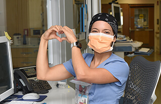 nurse making heart shape with hands