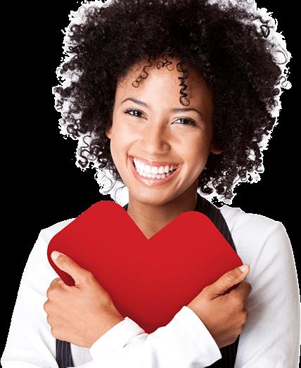 Woman holding CVS heart