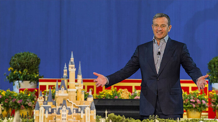Man presenting model of Cinderella's castle