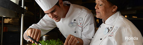 Aspiring chefs in the Disney Culinary Program trimming greens to be used in a recipe