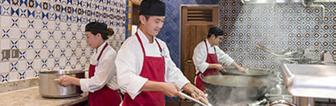 Chefs cooking in the kitchen at Shanghai Disney Resort