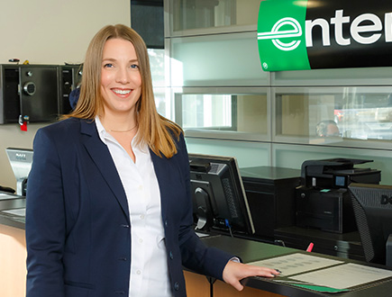 Andrea standing at Enterprise desk