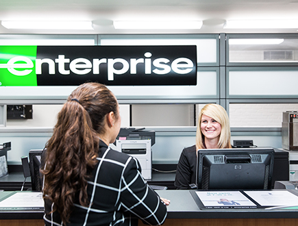 Sara with customer at the Enterprise welcome desk