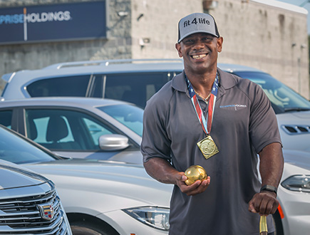 Frederick wearing a medal and holding a shotput