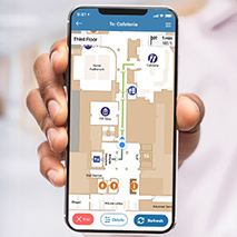 A smartphone showing an app with a map of a hospital on it