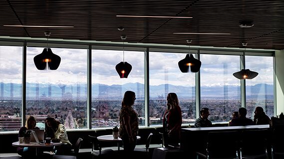 Image of interior of Spectrum Plaza showing Rocky Mountain views and a modern space for collaboration