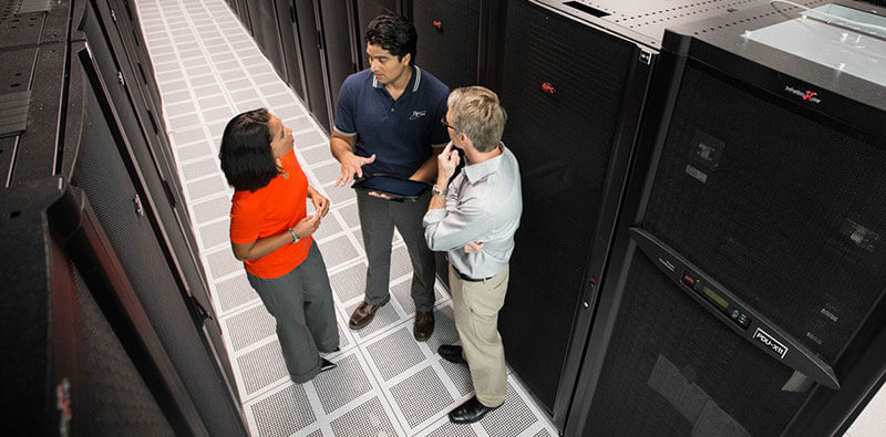 Employees chatting in the server room