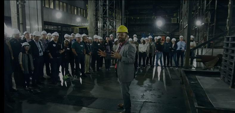 Lead engineer speaking with large team of engineers