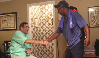 A driver shaking hands with a patient