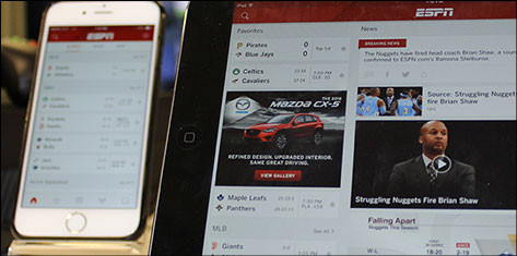 smart phone and tablet side-by-side displaying ESPN web properties