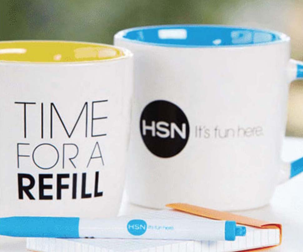 Mugs and pen with HSN logo and text