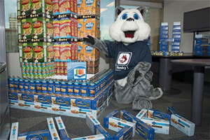 Husky mascot with donated food