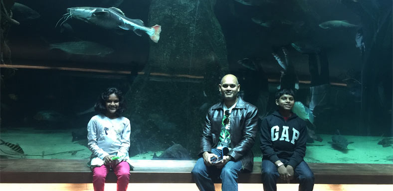 Clapton Dias and his family at an aquarium