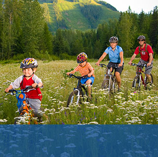 familiy biking in meadow