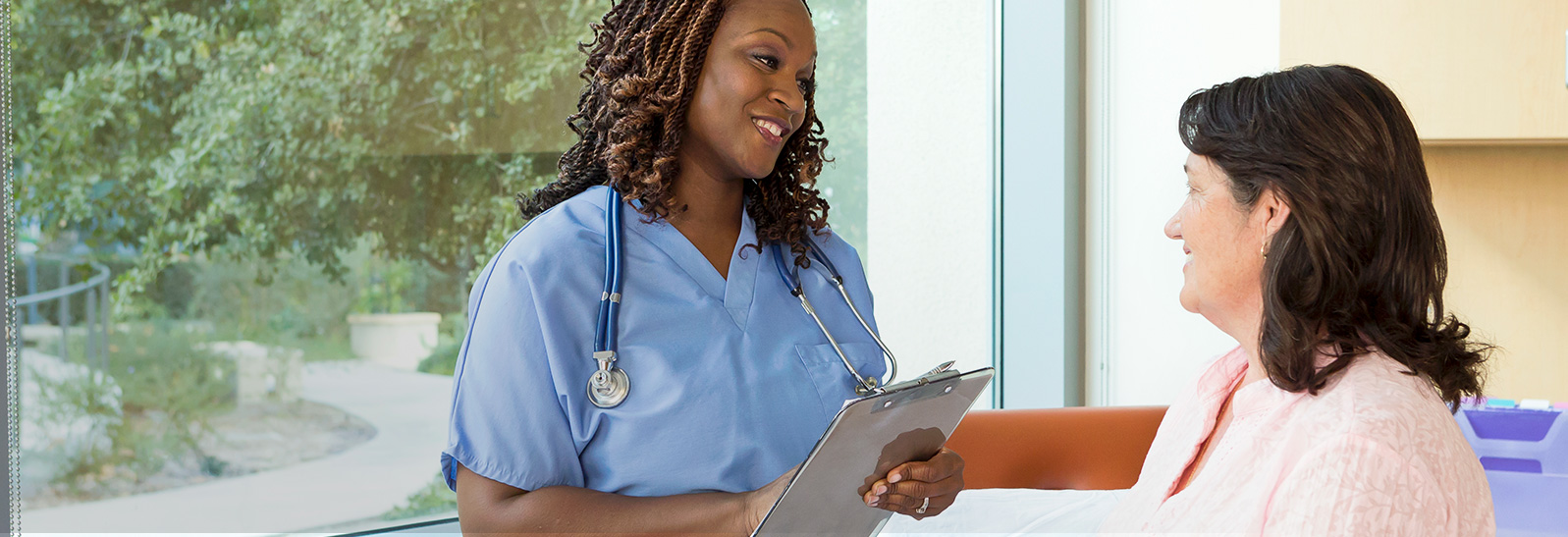 A registered nurse speaking to a patient