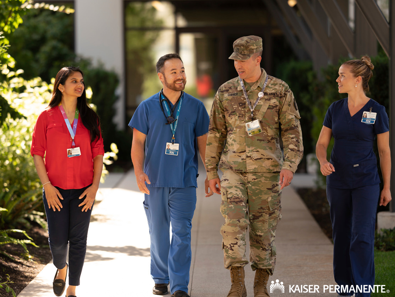 Brandon in his army fatigues walking with 3 other people