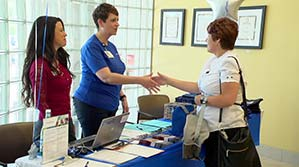 A physical therapist and a job-seeker shaking hands