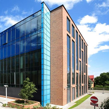 Corner perspective view of our Gdansk four-story brick and glass office building