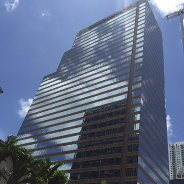 ground-to-sky view of the 30+-story professional building which includes Laureate's regional Miami office