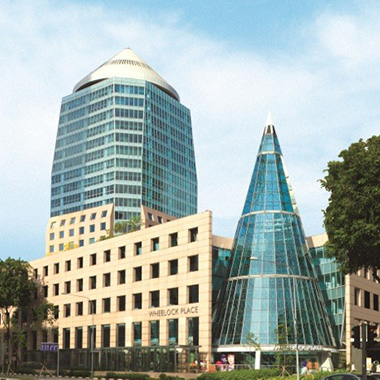 View of the conical glass pyramid entranceway alongside our modern Singapore office building