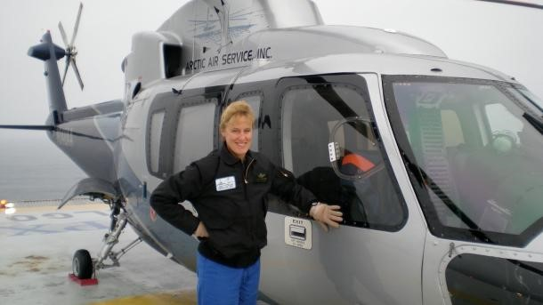 Melissa Mathiasen in front of an S-76A helicopter for offshore oil support.