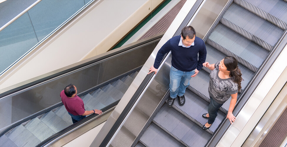 two people on escalator