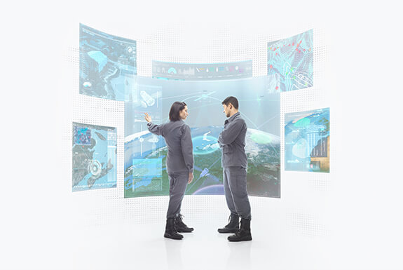 two people looking at holographic projections