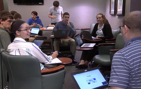Lockheed Martin interns in a meeting