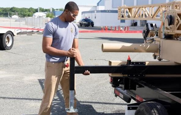 Lockheed Martin employee working on equipment outside