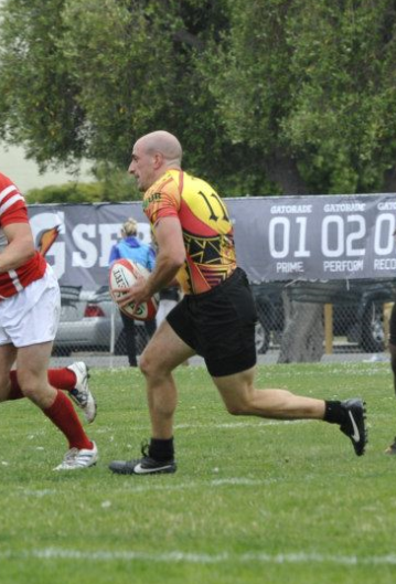 running with the ball during rugby game