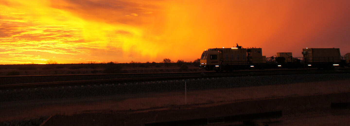 Silhouette of train at sunset