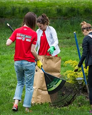 Group of volunteers performing yardwork