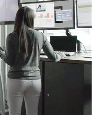woman working at a comuter terminal
