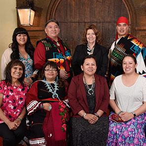 8 Navajo men and women in traditional dress