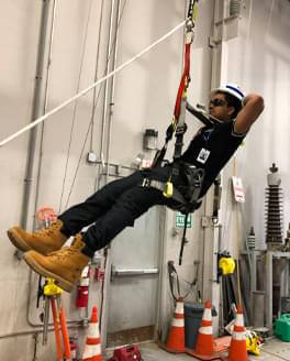 man repelling down a wall
