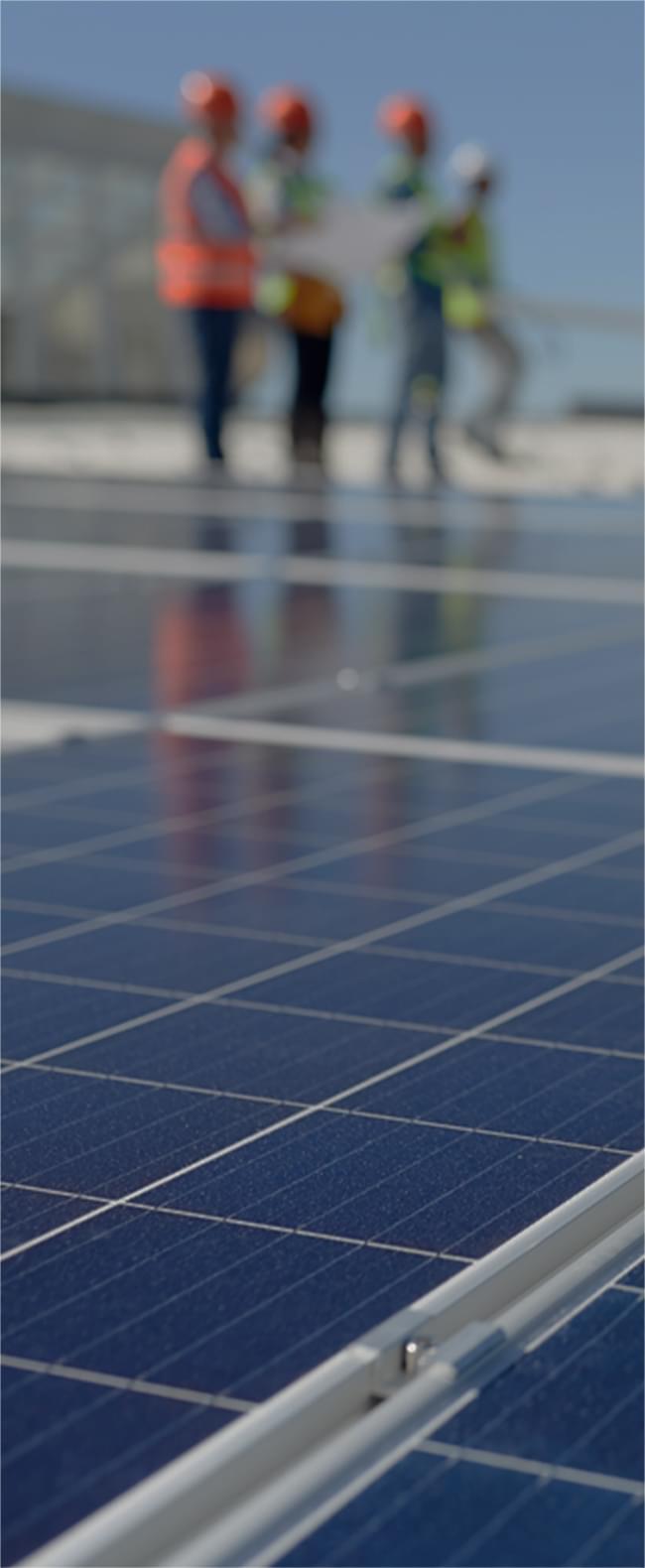 National Grid employees installing solar panels